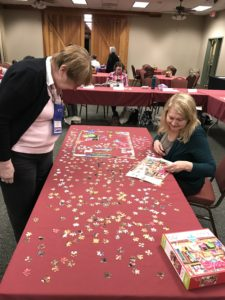 Andrea and Gloria puzzling